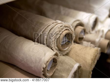 Close-up Set Of Linen Textile Rolls. Online Sale Or Tailoring Objects Concept. Fabrics Retail Store,