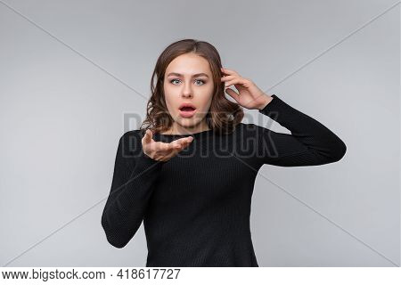 Shocked Young Brunette Woman Looks At Camera With Opened Mouth, Stare Fascinated With Disbelief At L