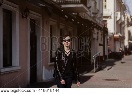 Beautiful Stylish Woman Wearing Black Leather Jacket. Girl In Sunglasses Dressed In  Leather Jacket.