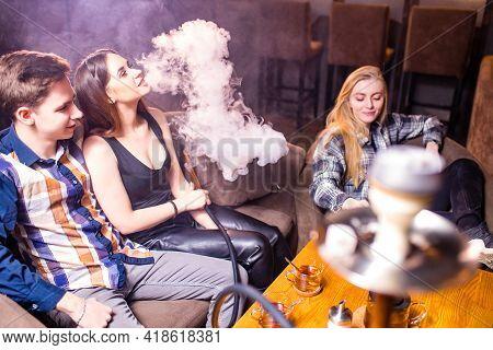 Friends Party In Hookah Lounge Smoking Shisha Night Time