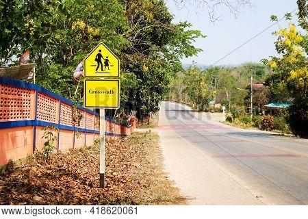 The School Zone Warning And Crosswalk Sign.