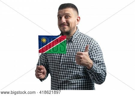 White Guy Holding A Flag Of Namibia And Shows The Class By Hand Isolated On A White Background. Like