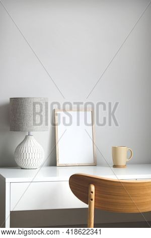 Empty Wooden Frame Mockup On Table In Scandinavian Style Living Room Interior.