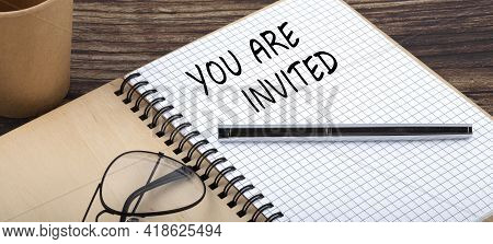 You Are Invited Words Written In An Office Notebook. Concept Business.