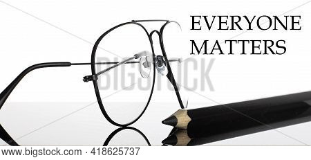 Everyone Matters Text. Glasses And Pencil Isolated On The White Background