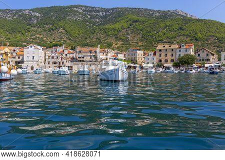 Komiza, Croatia; Vis Island - September 5, 2019:  12th Century Coastal Town Lying On The Island Of V