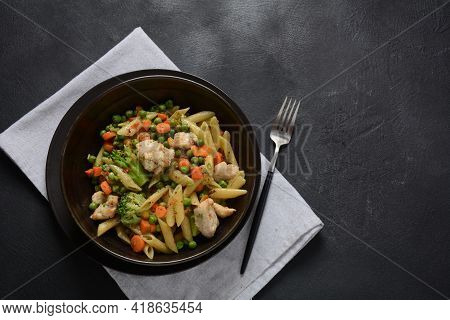 Pasta Salad With Baked Vegetables And Fried Pieces Of Chicken Breast . Penne Pasta With Broccoli, Be