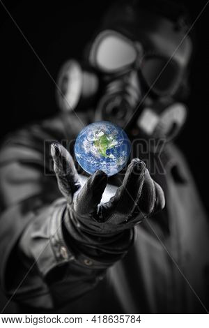 Menacing Entity Wearing Fallout Gas Mask Threatening Planet Earth With Gloved Hand.
