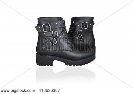 Two Black Lace-up Boots With Buckles And Straps, Isolated On White Background