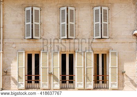 Typical Historic Building With Shutters In Historic Center Of Avignon, Provence