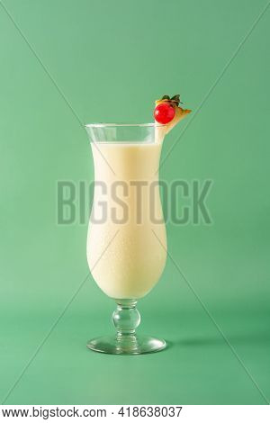 Pina Colada Cocktail In Glass On Green Background