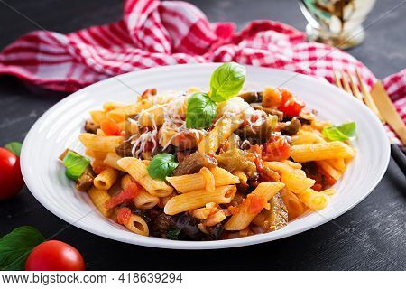 Pasta Penne With Eggplant. Pasta Alla Norma - Traditional Italian Food With Eggplant, Tomato, Ricott