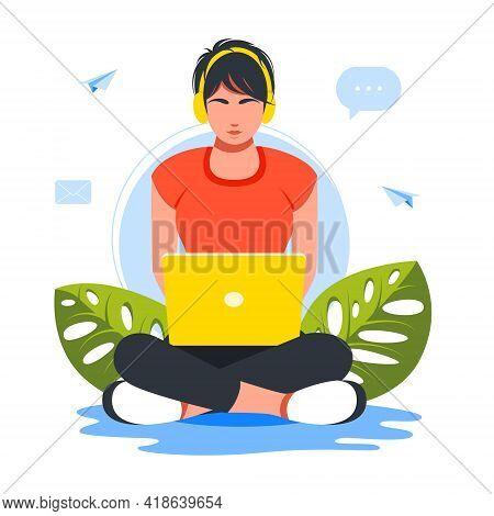 Business Woman Sitting In Lotus Position On Floor Using Laptop And Headphones.girl Wearing Headphone