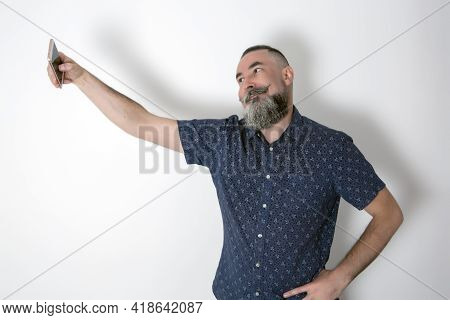 Caucasian Gay Hipster With Big Beard 40-45 Years Old, Taking A Selfie With The Smart-phone