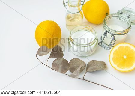 Set Of Eco Cleaning Products. Eco Sponges, Lemons, Apple Vinegar, Citric Acid And Soda On White Back