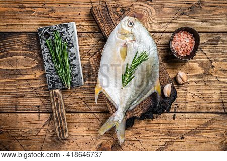 Raw Fish Sunfish Or Pompano On A Wooden Board. Wooden Background. Top View