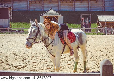 Lady In Amusement Park Walk With A Horse. Beautiful Young Woman With A Horse Outdoor. Horseback Ride