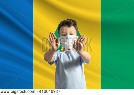 Little White Boy In A Protective Mask On The Background Of The Flag Of Saint Vincent And The Grenadi