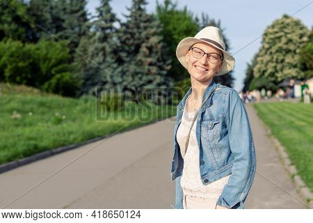 Happy Young Caucasian Bald Woman In Hat And Casual Clothes Enjoying Life After Surviving Breast Canc