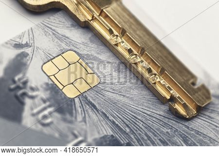 The Perforated Key On The Credit Card Next To The Chip. Data Encryption And Security Concept
