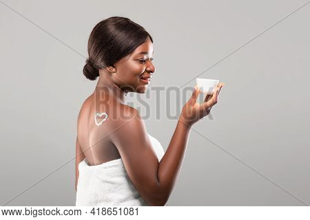 Skincare. Young Black Female With Flawless Skin Holding Jar With Moisturising Cream