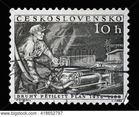 ZAGREB, CROATIA - SEPTEMBER 18, 2014: Stamp printed in Czechoslovakia shows Miner with drill, 2nd Five-Year Plan, circa 1956