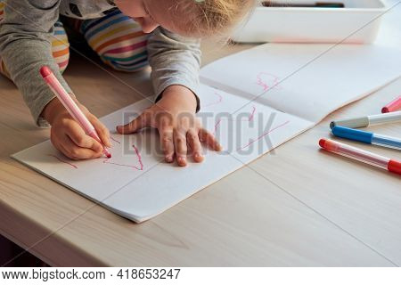 3 Years Girl Draws A Picture. Child At Home, Kindergarden And Preschool Closed During Covid-19