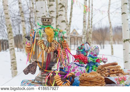 Festively Decorated Table For The Maslenitsa Holiday With A Samovar And Pancakes