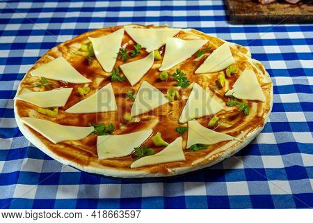 Homemade Cheese Pizza And Tarantella Sauce. Typical Italian Food. Cooking. Homemade Delights. Quick