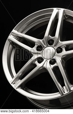 Alloy Wheel, Sporty Alloy, Star-shaped On Dark Background, Details Close-up Vertical Photo