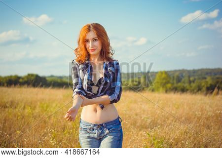 Free Relaxed Woman Enjoying Nature. Beauty Girl Outdoor. Freedom Concept. Beauty Lady With Red Hair