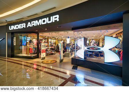 KUALA LUMPUR, MALAYSIA - CIRCA JANUARY, 2020: Under Armour storefront in Suria KLCC shopping mall in Kuala Lumpur.