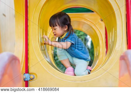 Portrait Image Of 2-3 Year Old Of Toddlerbaby. Happy Asian Child Girl Playing With Slider Bar Toy