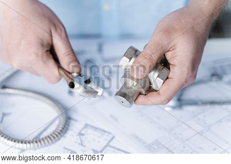 Plumbing Project In House.drawing,diagrams,plan Of Water Supply Of Apartment,building.man Repairer M
