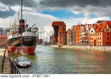 Gdansk, Poland - April 25, 2021: Old town of Gdansk with Soldek ship at spring, Poland. Gdansk is the historical capital of Polish Pomerania with beautiful architecture