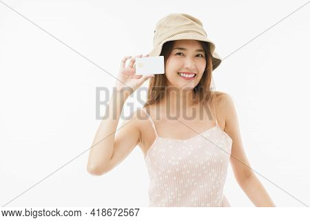 Medium Close Up Shot Of Young Attractive Woman Wearing Brown Hat And Show Up A White Smart Card And