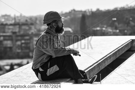 Roofer Working. Roofer Working Tool. Construction Industry And Waterproofing. Roofer Working On Roof