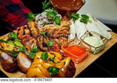 Shish Kebab With Grilled Vegetables, Lavash And Sauces. Close-up, Selective Focus