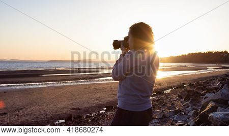 Adventure Travel Photographer At West Pacific Ocean Coast. Colorful Sunny Sunset. Adult White Caucas
