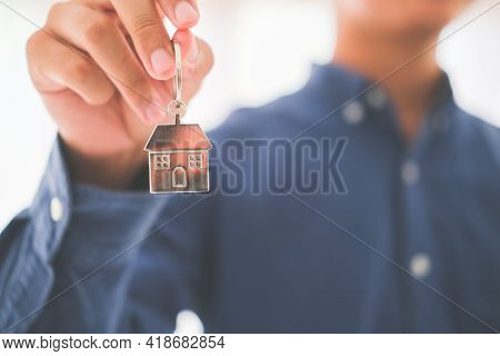 Real Estate Agent With House Model And Keys..