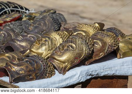 Handmade Image Of Buddha Face And Other Souvenir In A Tourist Stall On The Street Market Near Inle L