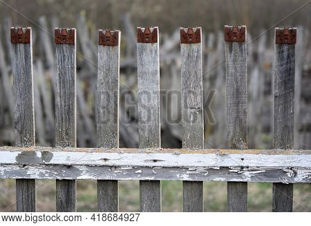 A Fence Made Of Wooden Beams In The Village