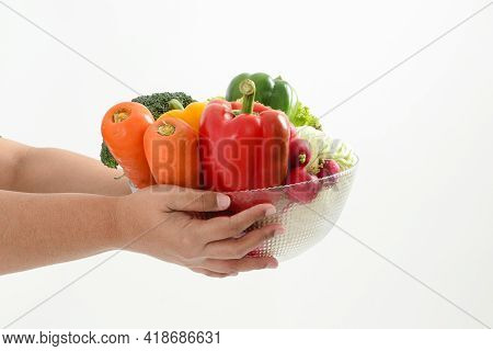 Fat Woman Holding A Bowl Of Fresh Organic Vegetables Food For Good Health. The Concept Of Losing Wei