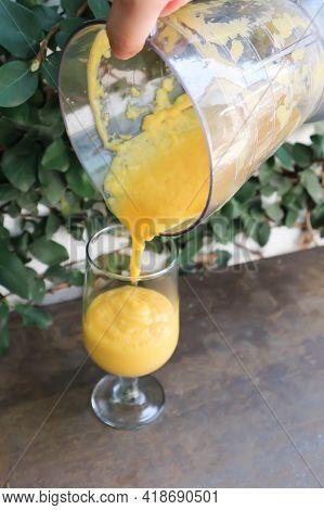 Mango Smoothie Or Mango Yogurt Smoothie ,pouring Mango Yogurt Smoothie To The Glass