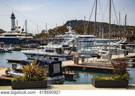 Spain, Barcelona, March, 2021: Luxury Yachts In Port Vell Old Harbour On Sunset. Port Vell And Rambl