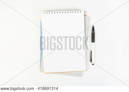 Top View Of An Open Notebook With A Pen On A Gray Background, School Notebooks With A Spiral Spring,