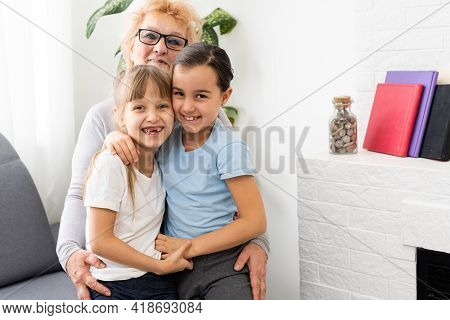 Closeup Summer Portrait Of Happy Grandmother With Grandchildren Outdoors At Home