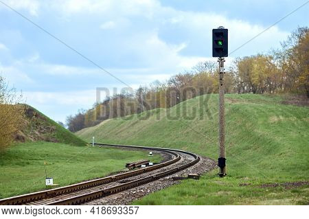 Selective Focus Railway Green Lantern Of Semaphore Railroad Enable, Allow Permit Track That Twists A