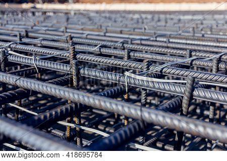 Construction Rebar Steel Work Reinforcement. Reinforcements Steel Bars Stack. Close Up Steel Constru
