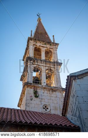 Bell Tower Of The Church Of Our Lady Of The Annunciation At The End Of A Narrow Street In The Town O